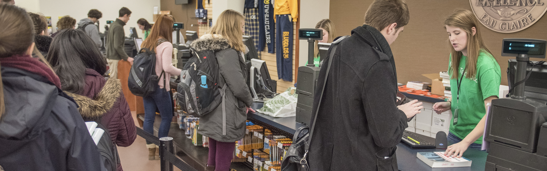 Students flock to the campus bookstore on their first day back.