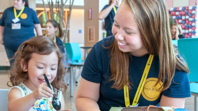 Emma Nickerson works with a young girl at a California hospital during a summer immersion program.