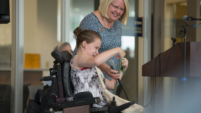 VIcky Thomas and a student frmo Services for Students with Disabilities