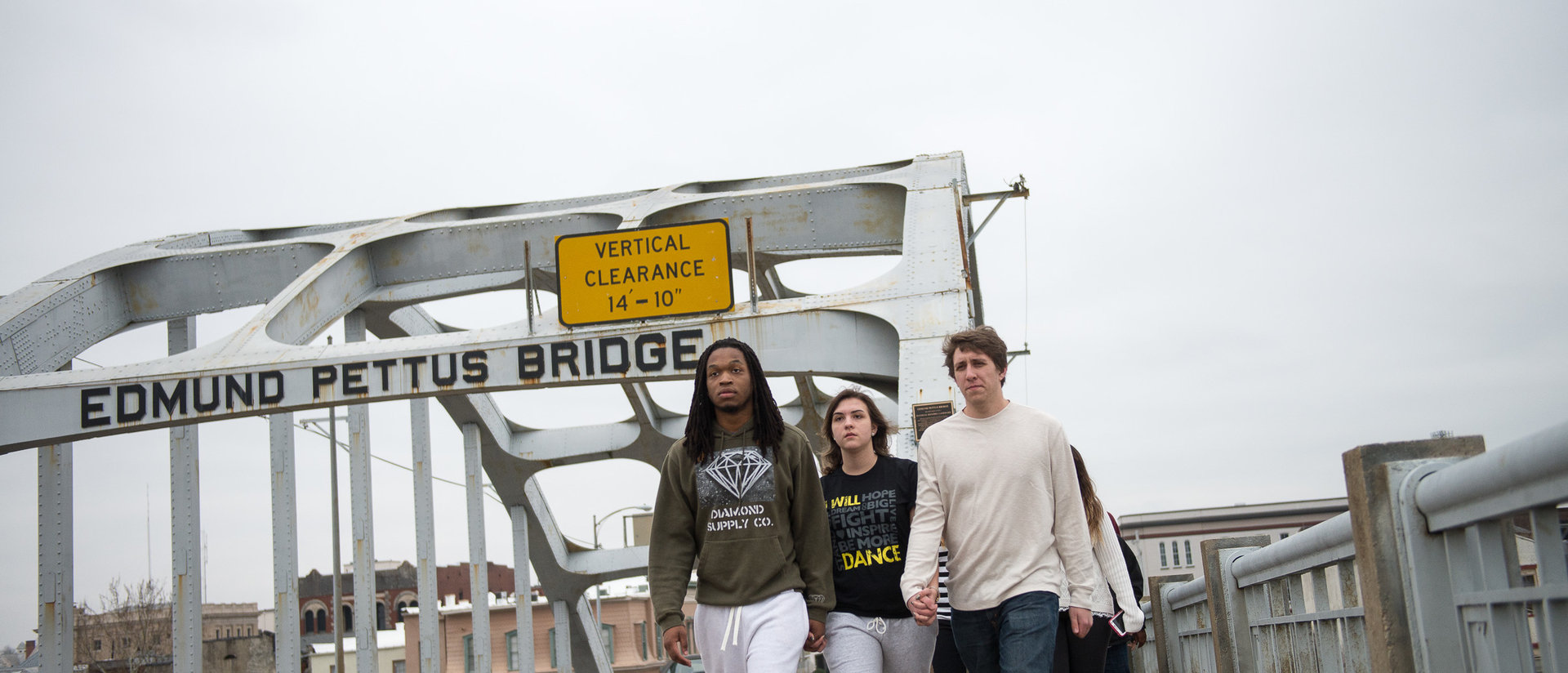 Blugold students walking across the Edmund Pettis Bridge in Selma