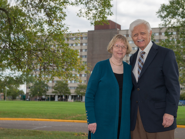 Marilyn and David Karlgaard in front of Karlgaard Towers