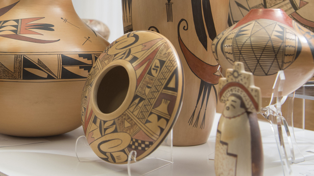 Greg Kocken works with pieces from LaBelle Miller Southwest Pottery Collection