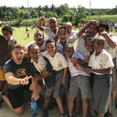 UWEC student poses with Fiji school children