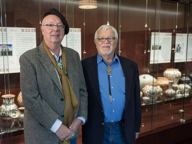 Richard LaBelle and Al Miller with pottery collection