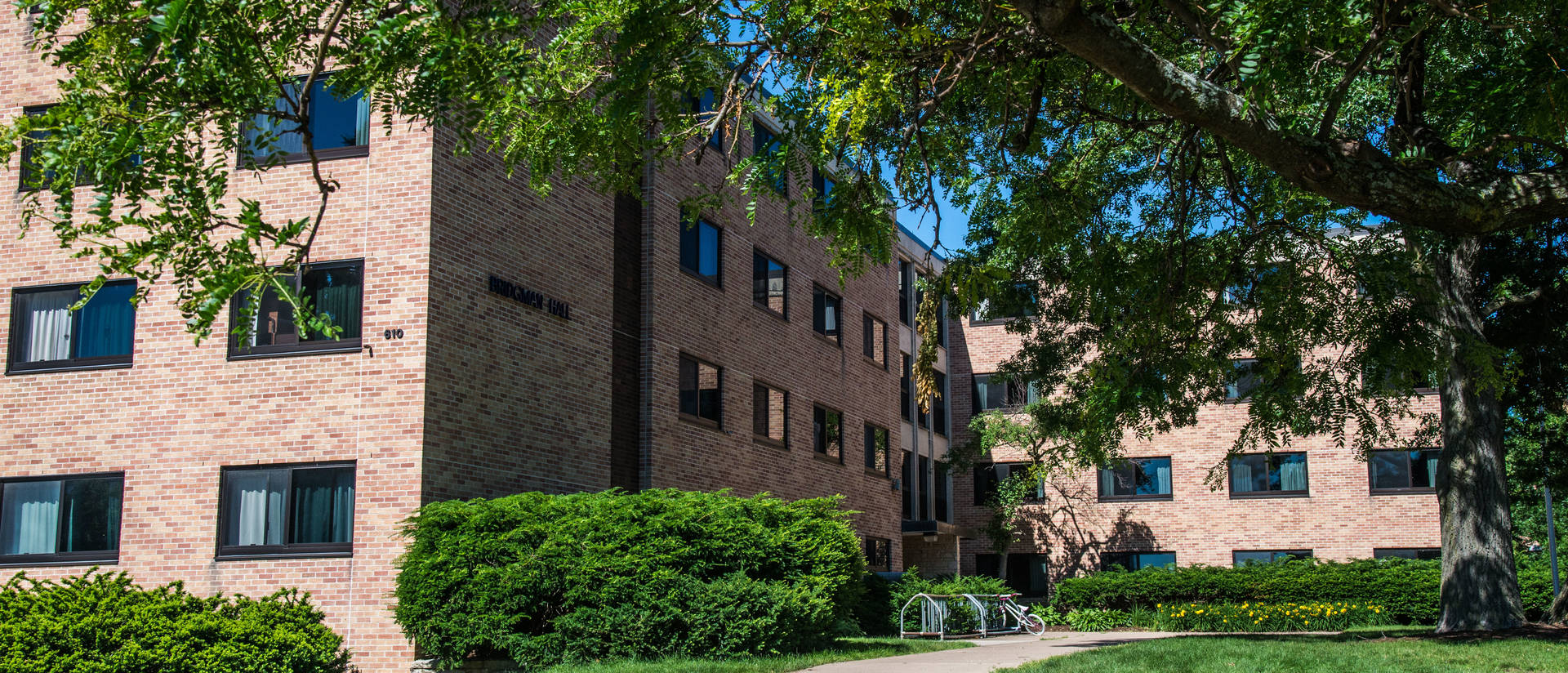 Exterior image of Bridgman Hall including walkway