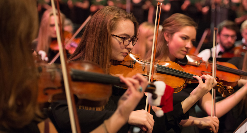 viola players perform with symphony at Holiday Concert 2016