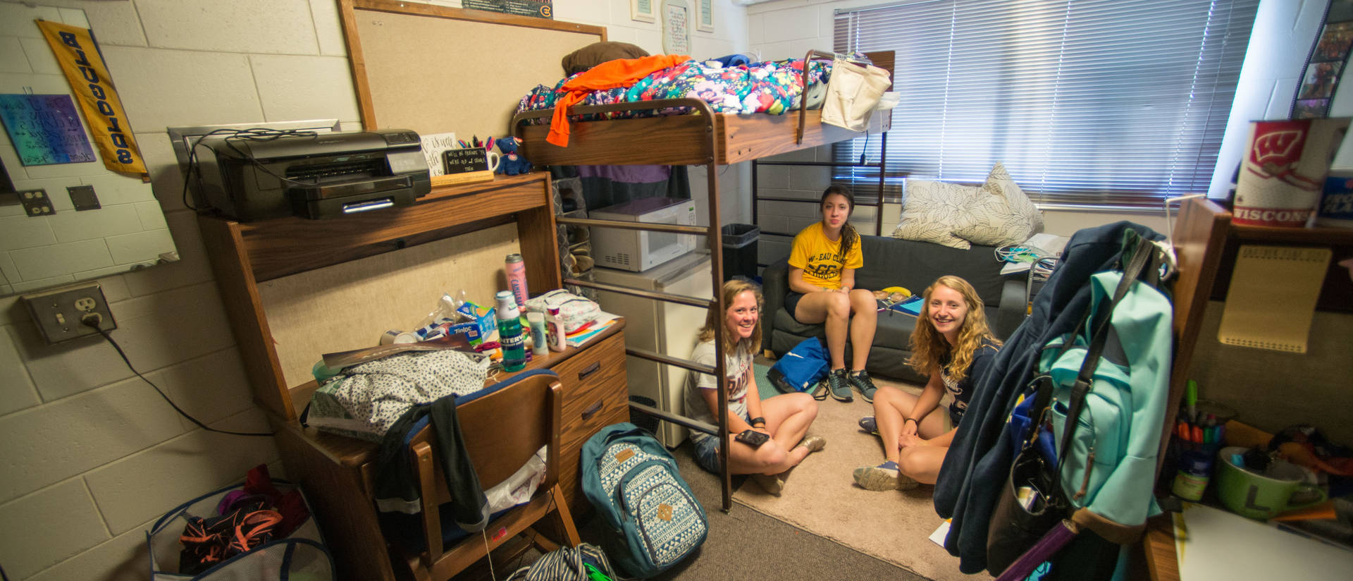 Three UWEC students sitting in their dorm room