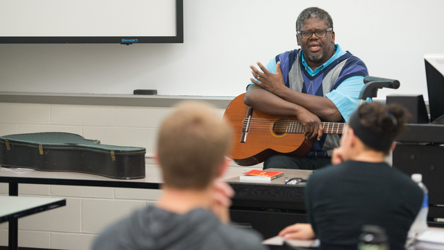 Professor David Jones during a History of Rock and Roll honors class, 2015.