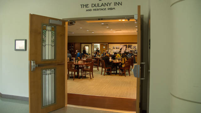 Picture looking into Dulany Inn with students eating at tables