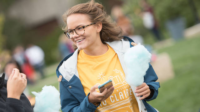UWEC student enjoying the event on the campus mall on the first day of classes