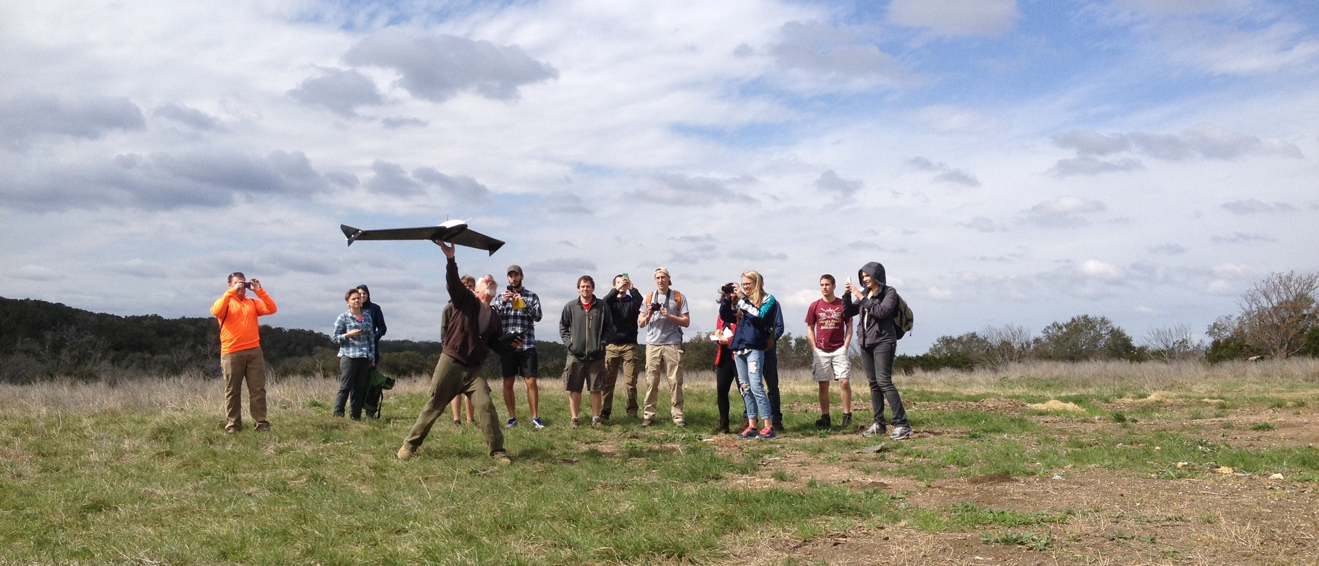 Students and professor of geography feildsmeinar launching an air craft in Texas