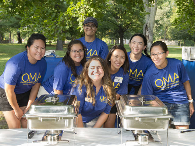 Students staff at OMA picnic