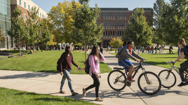 Campus mall students on foot and bikes