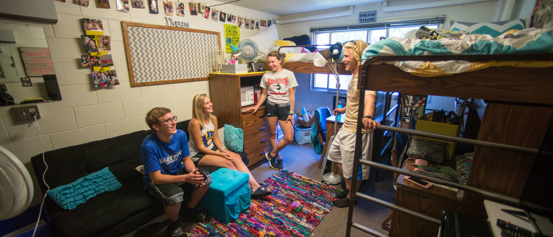 Four UWEC students hanging out in their dorm room