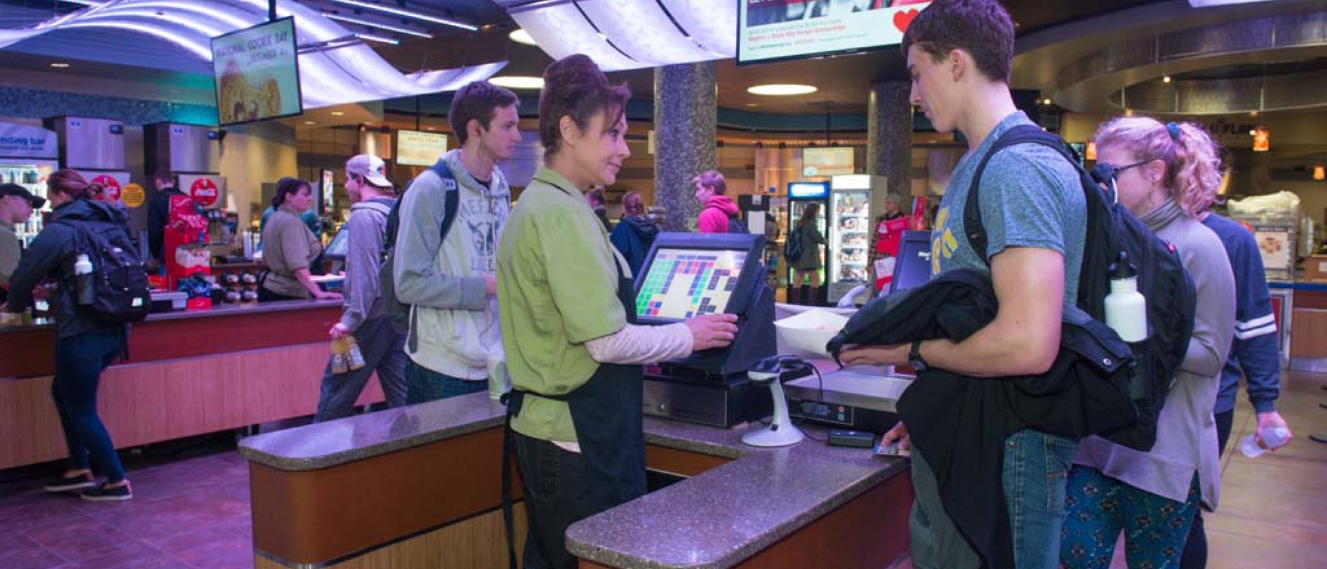 Student buying lunch in Davies Center