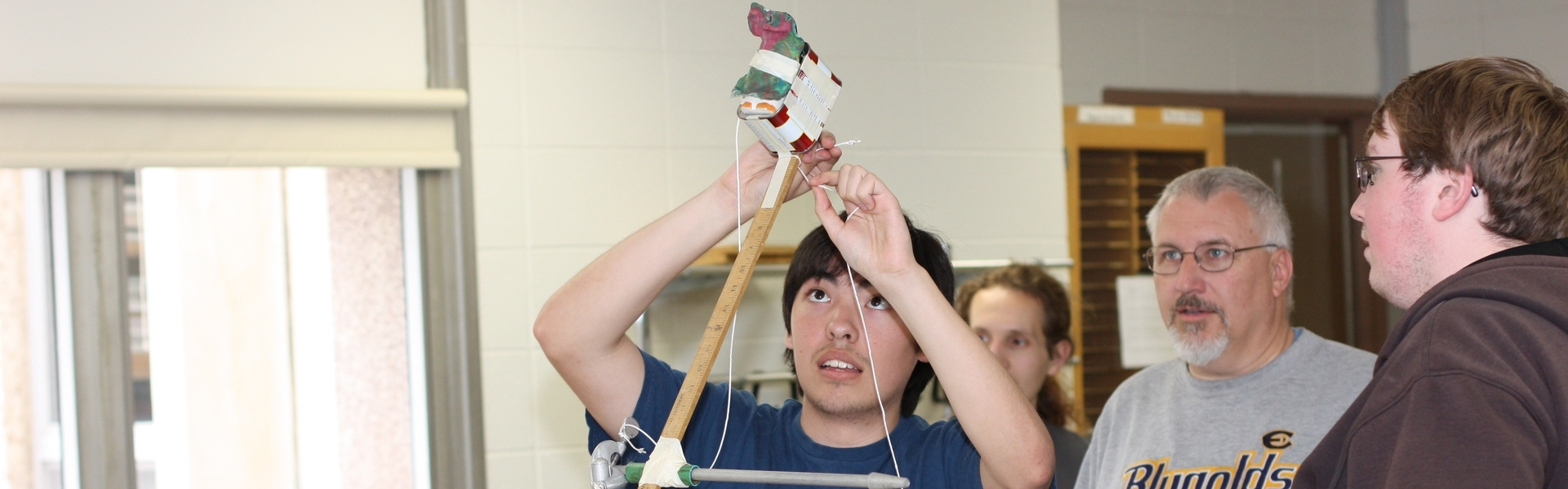 Students exploring physics and astronomy in a laboratory setting.