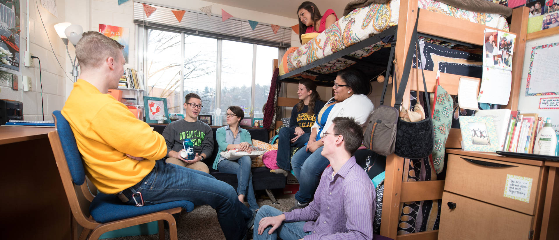 A Group of UWEC students gathered in a dorm room socializing
