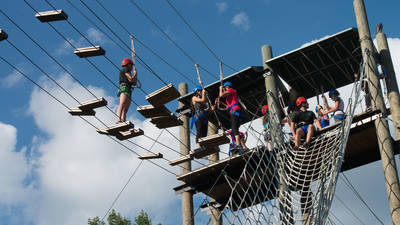 People out on the high ropes course