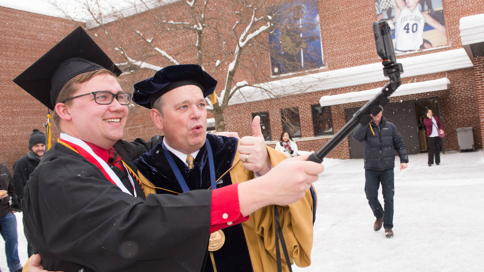Chancellor Jim and graduating student December 2016