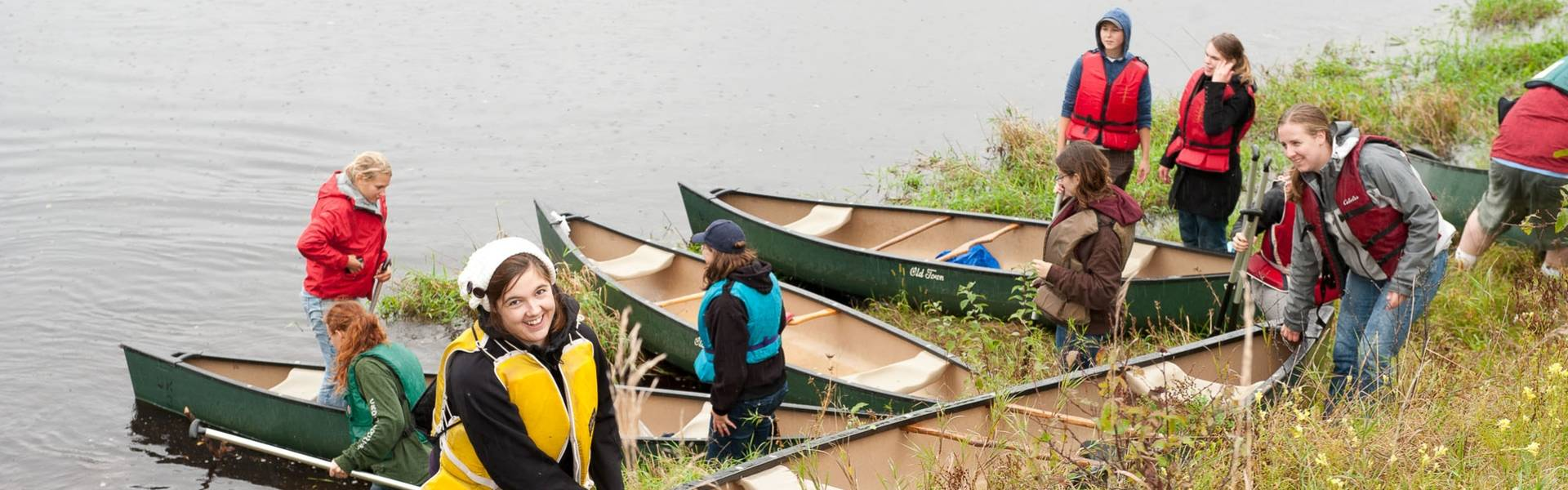 Geography students taking canoes out for research.
