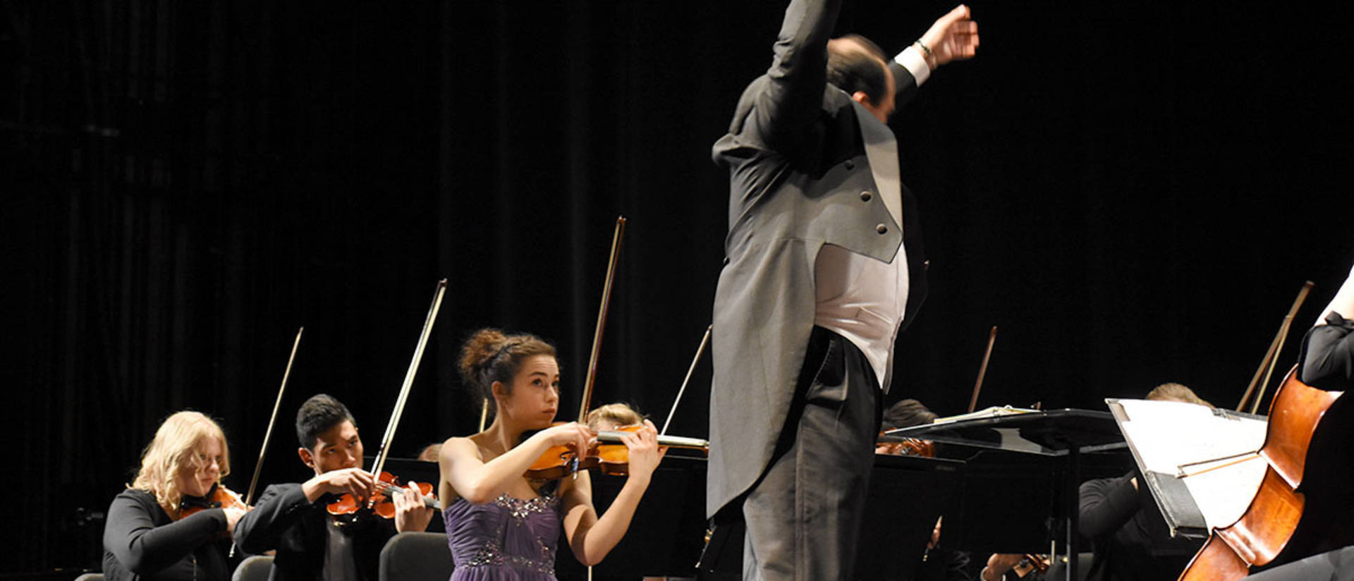Anne Schreiber, violin, and student conductor Carlos Rojo