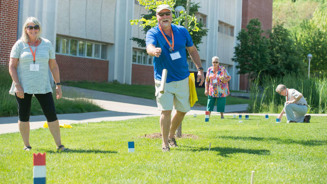 Men and women playing kubb at Senior Americans Day program put on UW-Eau Claire Continuing Education