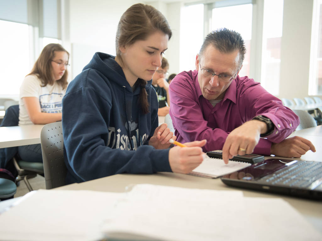 University of Wisconsin-Eau Claire student and professor looking at problem