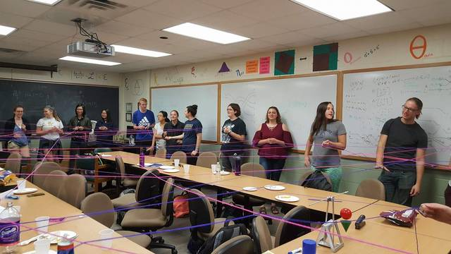 Math Club student doing string game