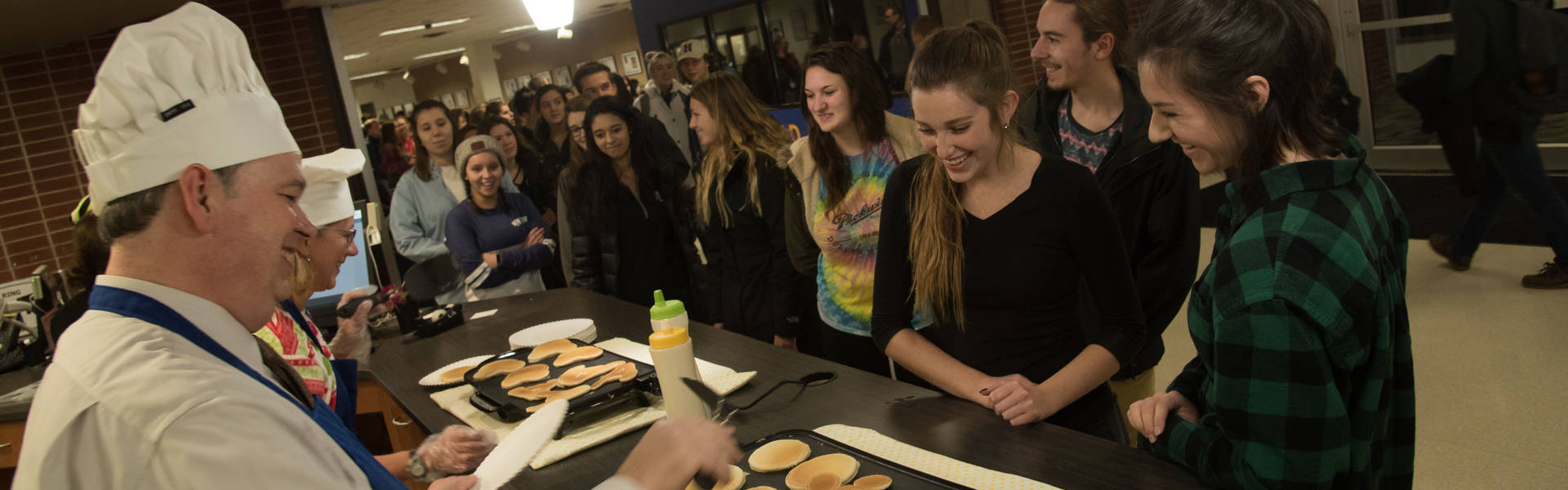 Chancellor Jim flips pancakes in the library for finals week.