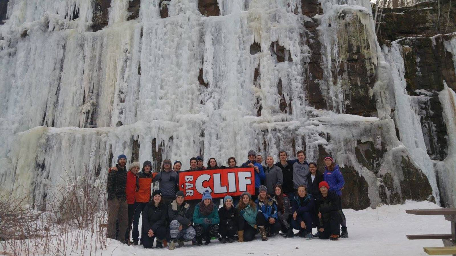 Students in front of ice wall on a climbing trip