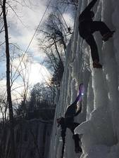 Students scaling an ice wall on winter climbing trip