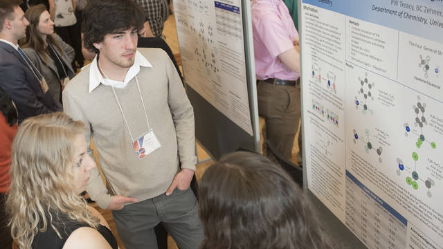 Students with research posters at CERCA