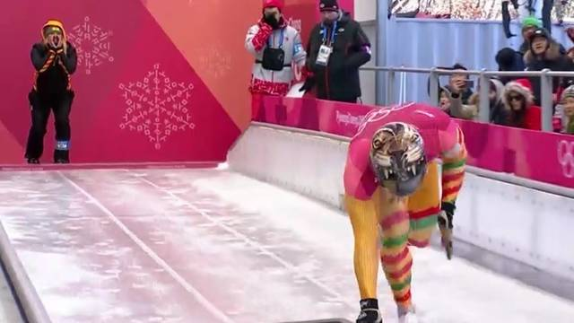 Blugold Lauri Miller Bausch coaches Ghana's Akwasi Frimpong as he begins a skeleton race during the 2018 Winter Olympics.