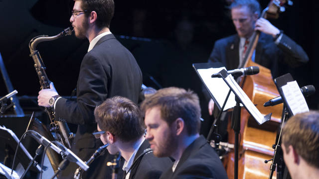 Student saxophonist solos during jazz performance