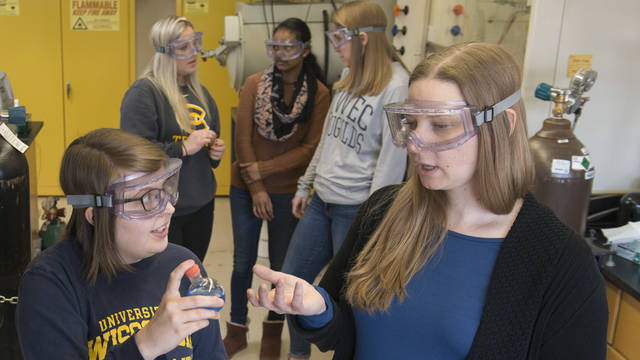 Dr. Liz Glogowski with students in materials science lab