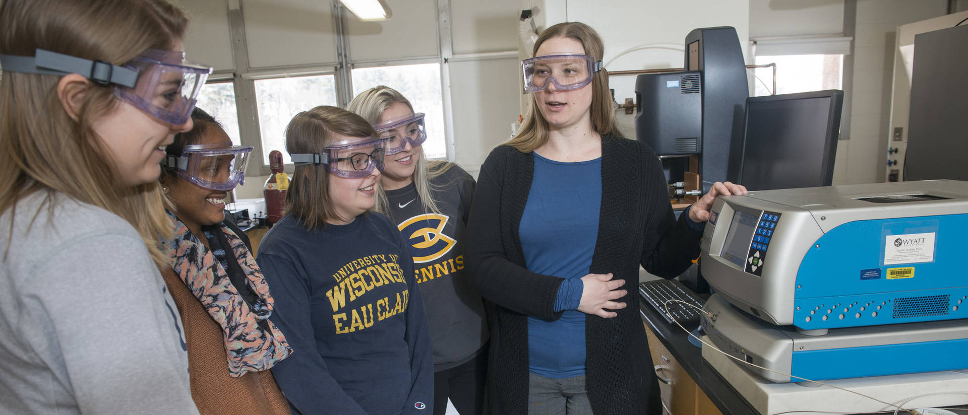 Liz Glogowski and student researchers in materials science lab