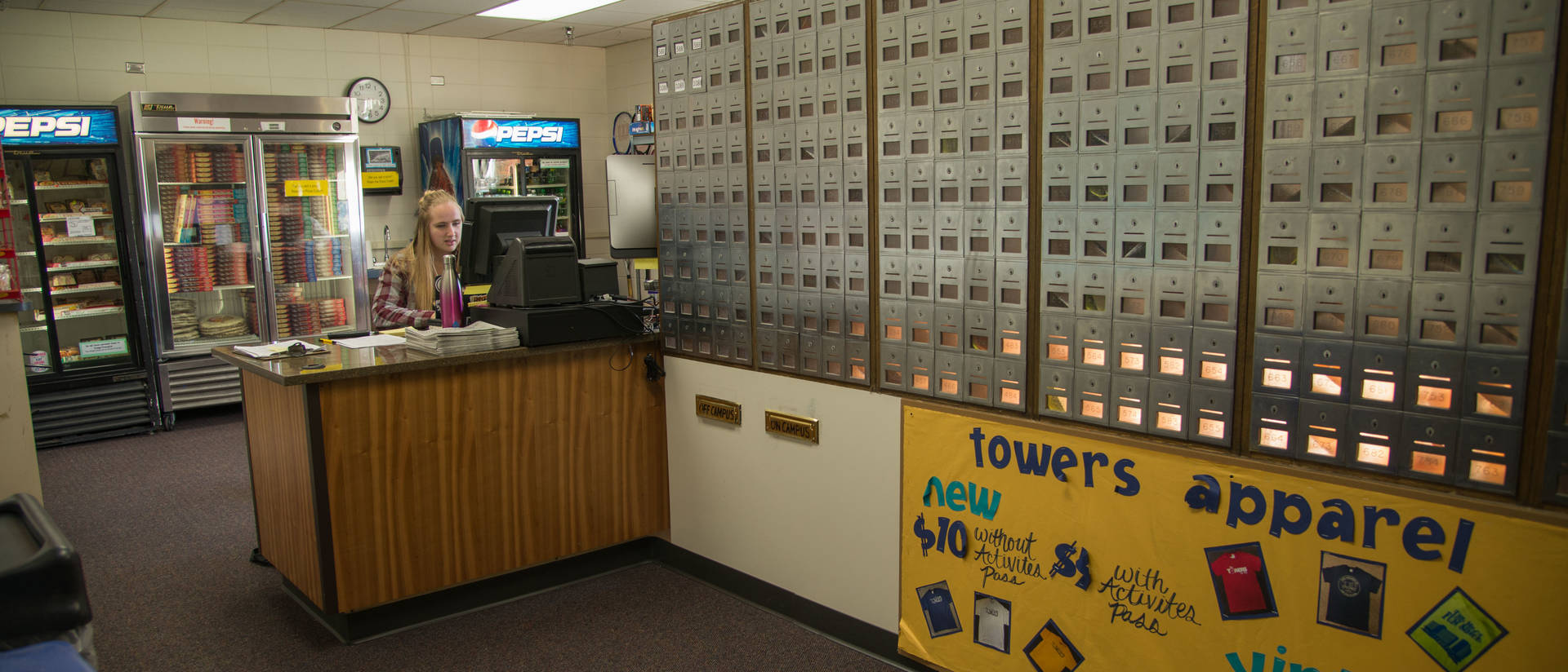 student working front desk in residence hall