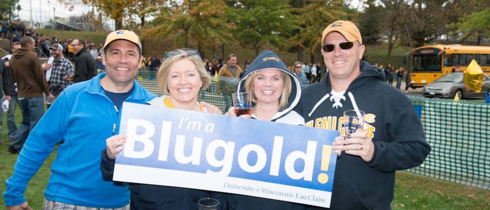 Happy Blugold Alumni at UW-Eau Claire homecoming in Carson Park.