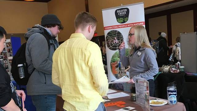 Students talk to organizations about volunteering opportunities at the service-learning and community engagement fair.