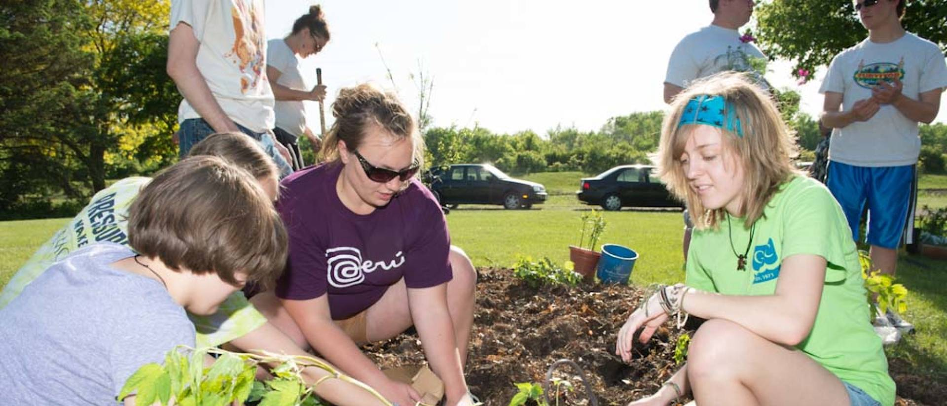 Students volunteer to plant in the community garden near Phoenix park
