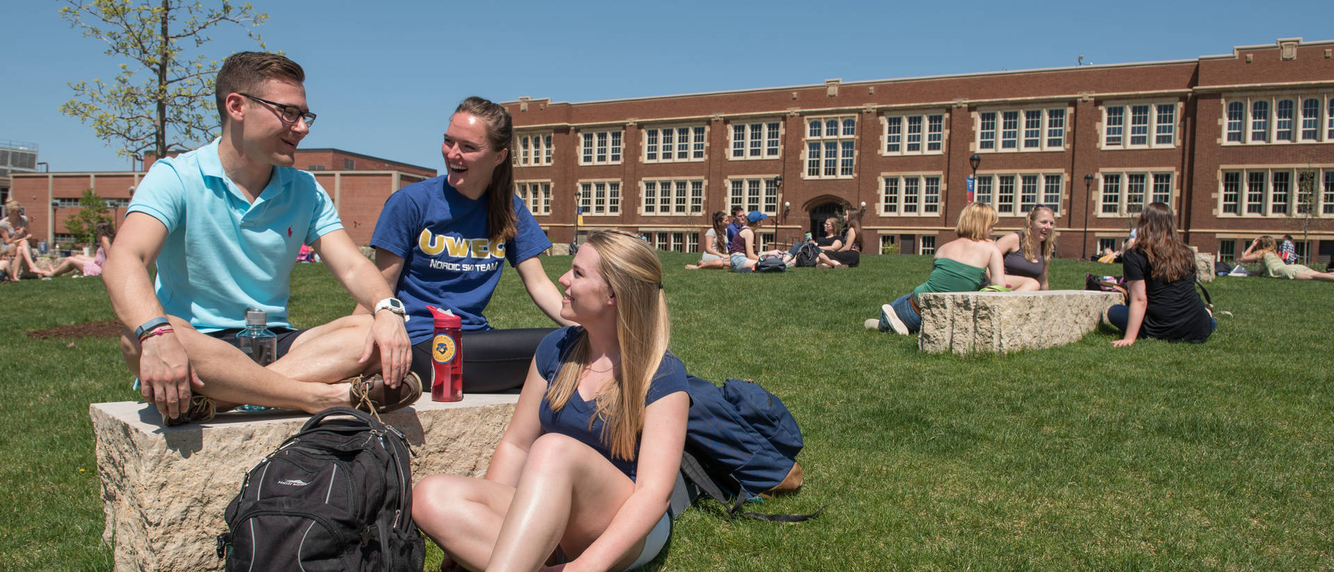 Students enjoy lower campus on a warm spring day.