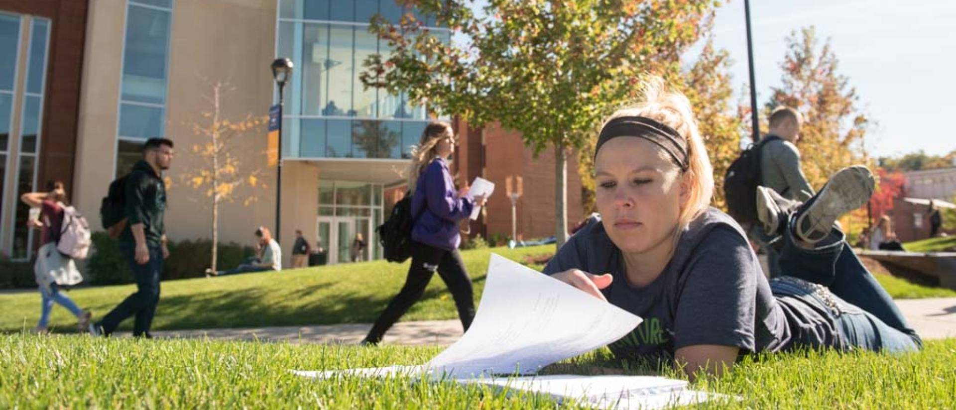 Students study and make their way around lower campus on a warm fall day.
