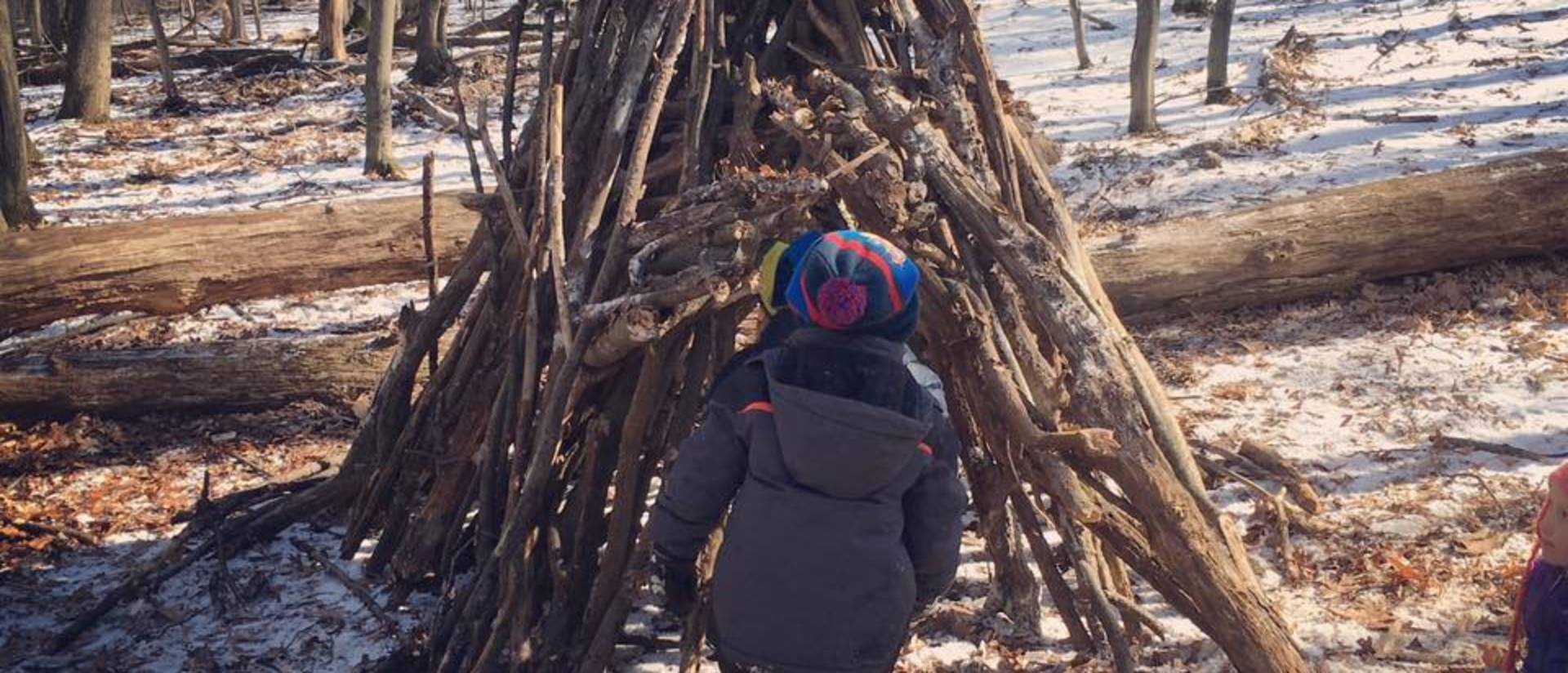 Kids at the children's nature academy building a fort