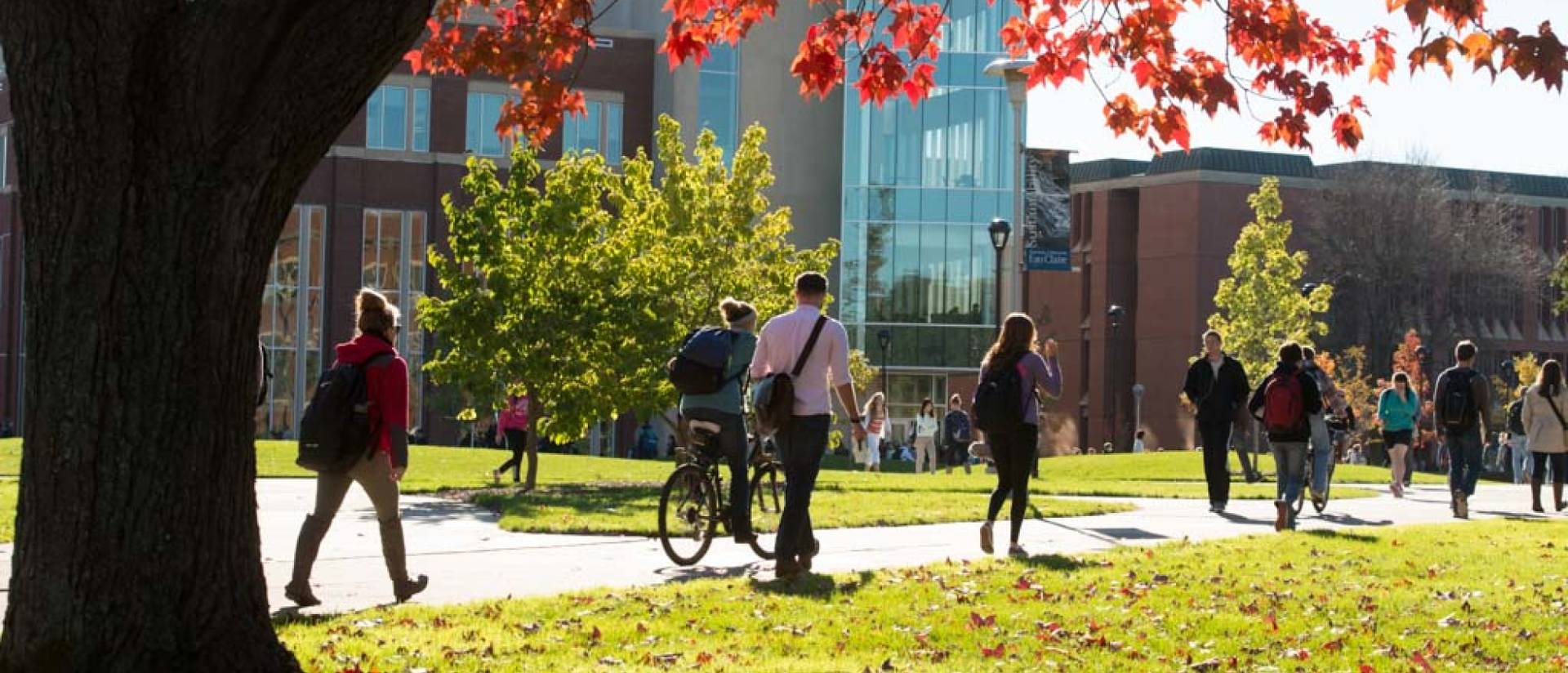 Students walk through lower campus on a beautiful fall day