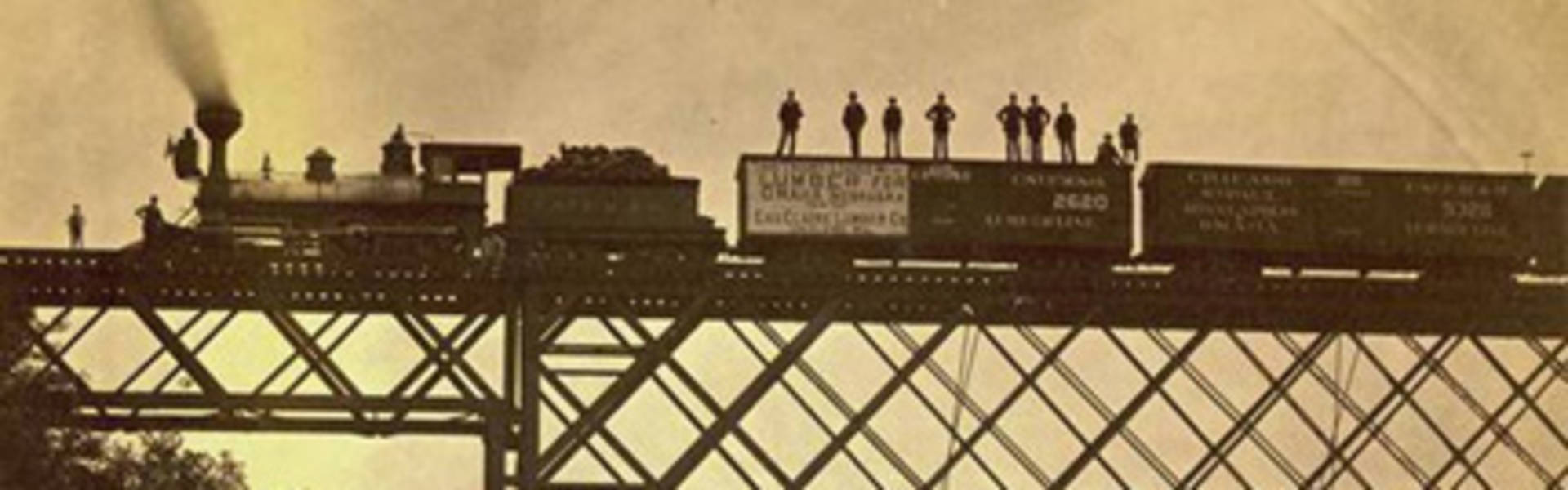 Chippewa Valley Lumber train crossing bridge in 1800s